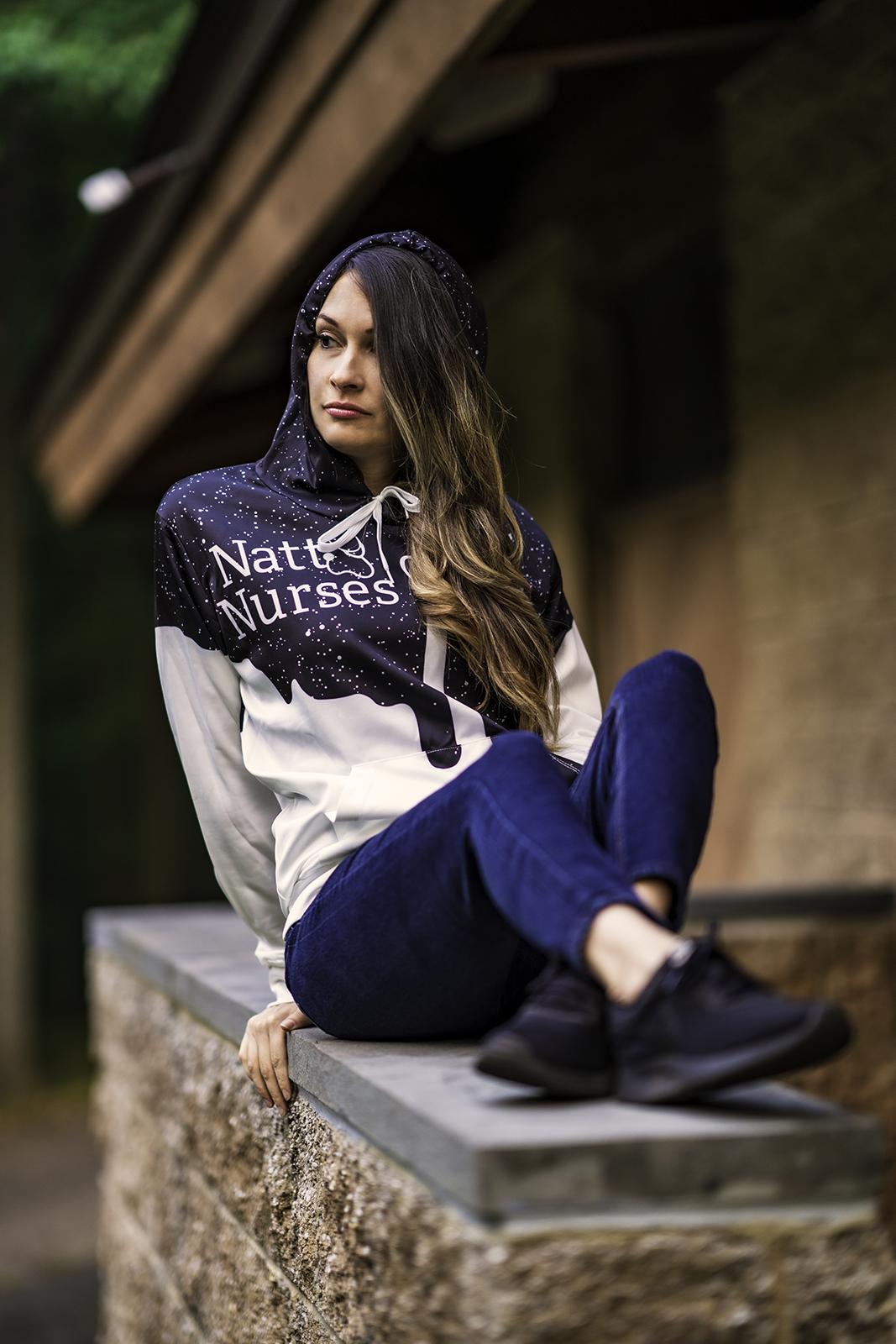 Girl with Natty Nurse hoodie on