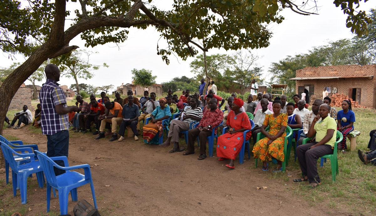 Water Compass staff member leading a community workshop on hygiene practices