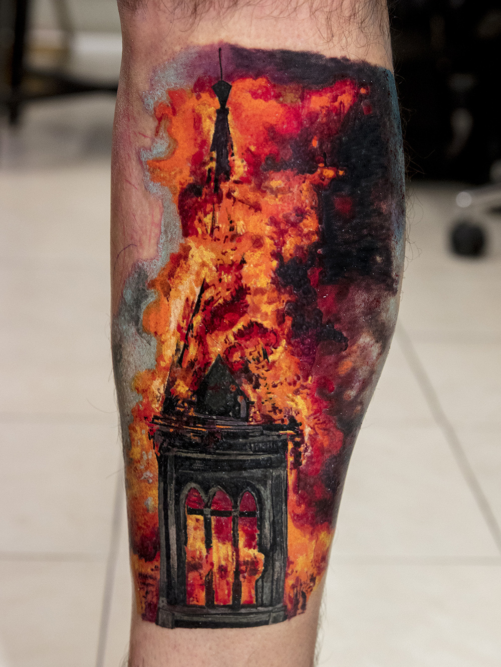 Building on fire tattoo by Mikhail Andersson