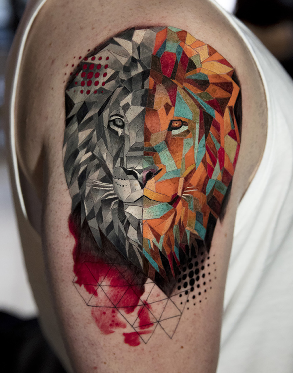 geometric lion tattoo by Mikhail Andersson