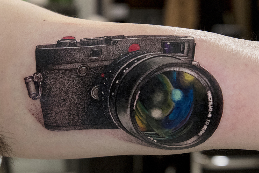 camera tattoo by Mikhail Andersson