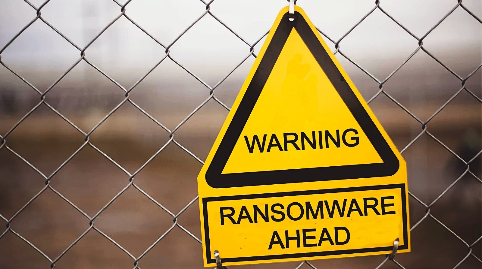 """Warning sign that says """"Ransomware Ahead"""" on it"""