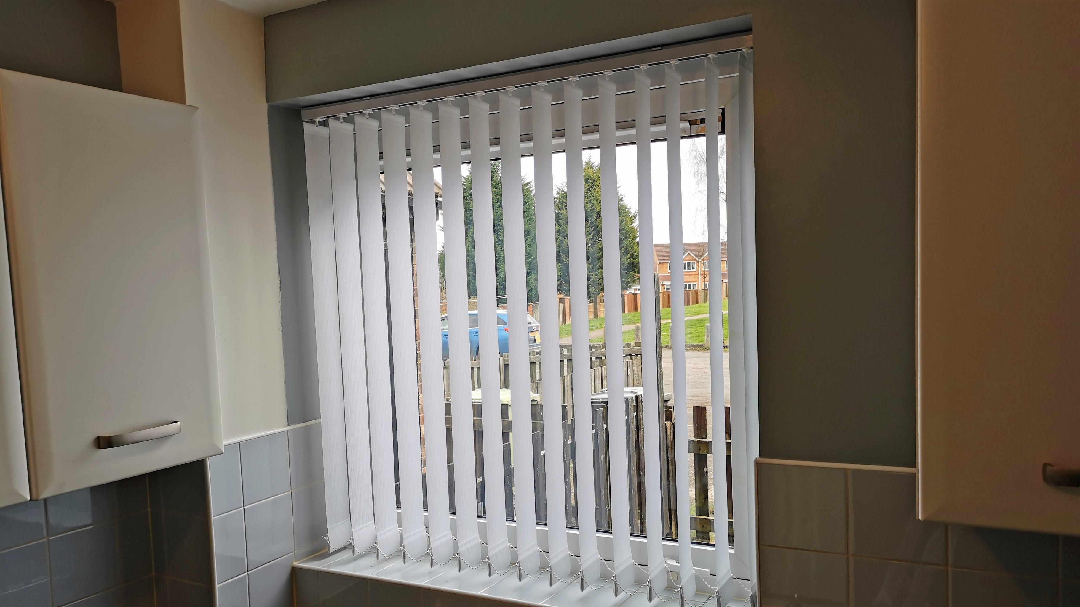 Vertical blinds in kitchen