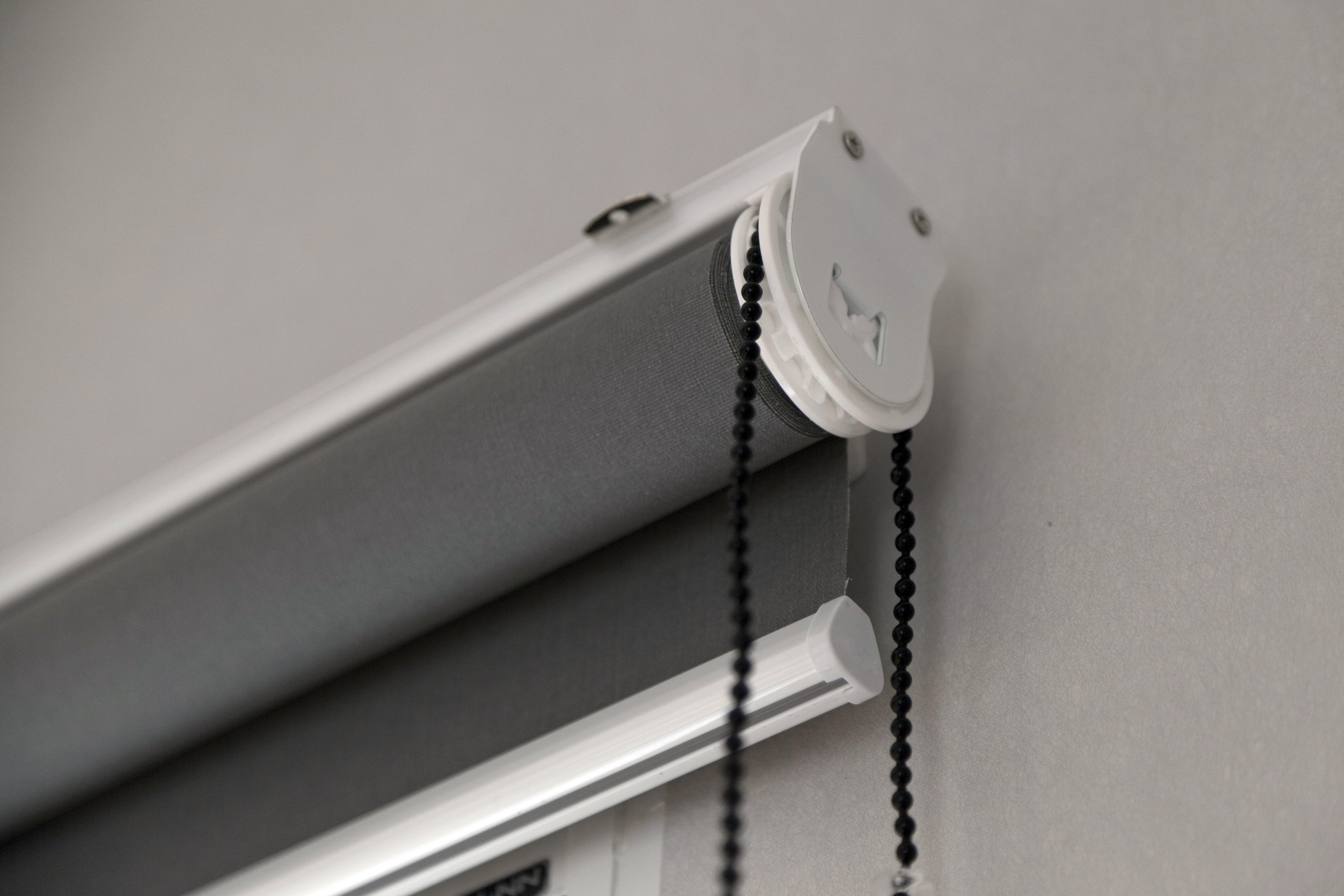 A light grey roller blind