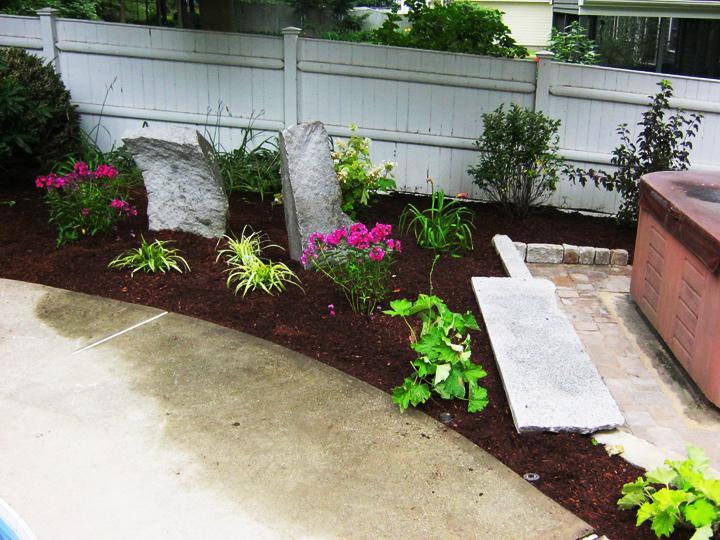 new england landscaper Reading, MA complete renovation: natural design plantings, large decorative granite rocks, irrigation
