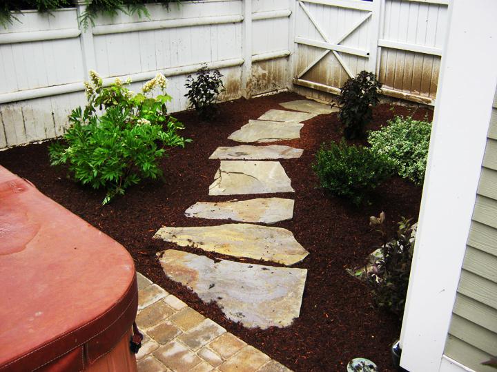 new england landscaper Reading, MA large irregular bluestone stepping stones, plantings, irrigation