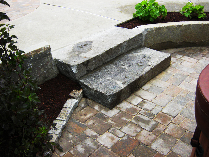 new england landscaper Reading, MA reclaimed granite curbing and steps, antique cobblestone edge, paver patio, irrigation