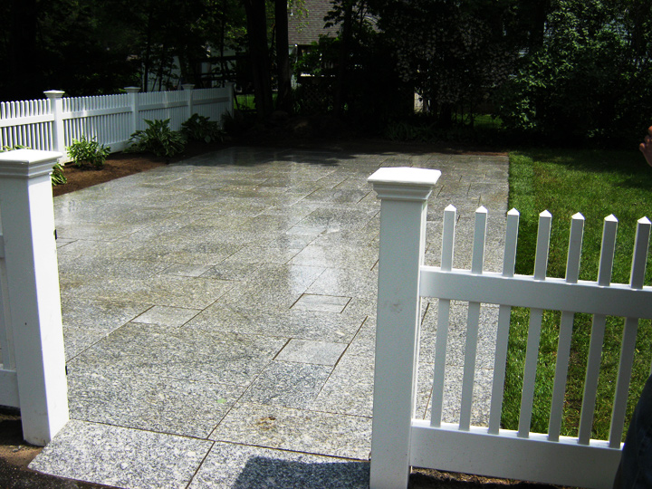 new england landscaper Bedford, MA granite pattern patio, plantings, fence, irrigation