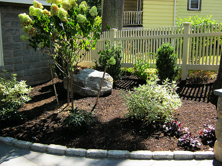 new england landscaper Melrose, MA plantings, stone accents, bluestone stepping stones, antique cobblestone edge, irrigation