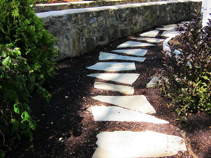 new england landscaper Melrose, MA natural plantings design, bluestone stepping stones, antique cobblestone edge, irrigation