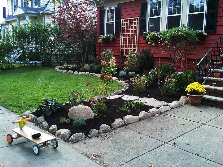 new england landscaper Arlington, MA plantings design, trellis, natural round rock edge