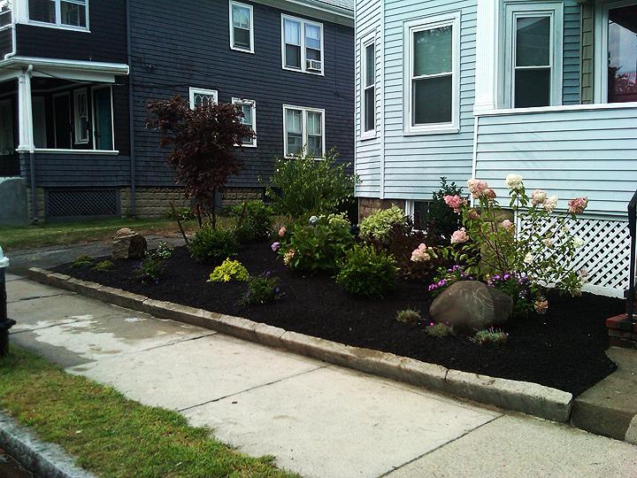 new england landscaper Arlington, MA plantings design, flower bed, ornamental rock landscape pieces