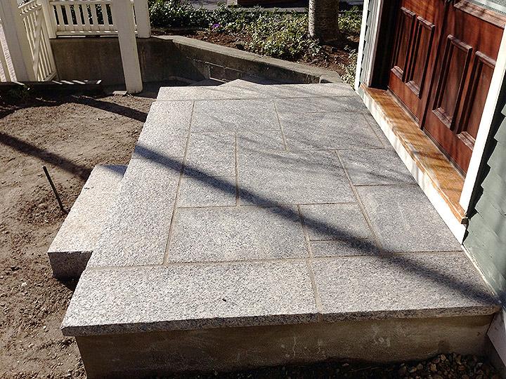 new england landscaper Cambridge, MA granite stairs, granite landing, granite walkway