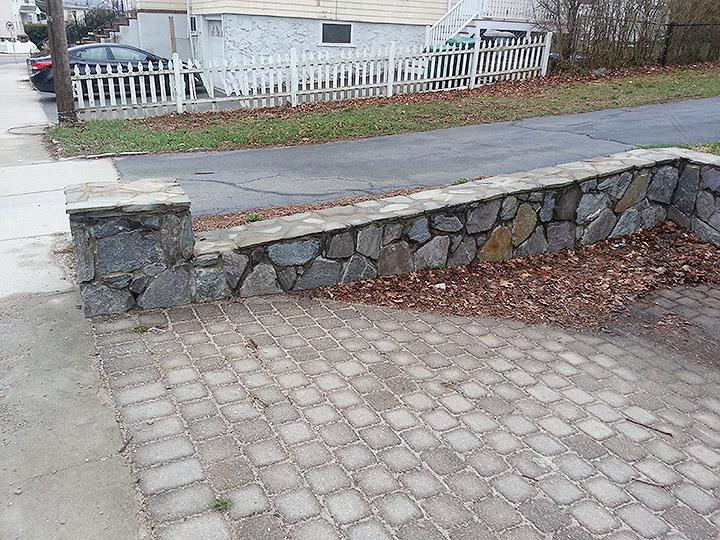 new england landscaper Medford, MA natural stone retaining wall, natural stone column, paver driveway