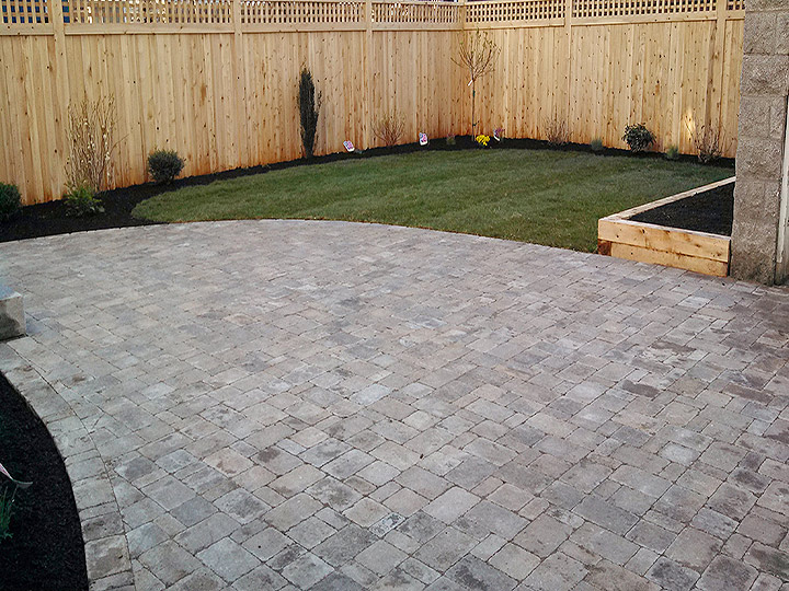 new england landscaper Somerville, MA granite steps, stone landing, paver driveway patio, sod, plantings, irrigation, raised planter box
