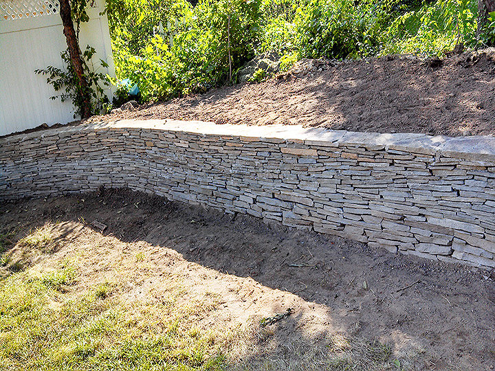 new england landscaper Medford, MA natural stone retaining wall