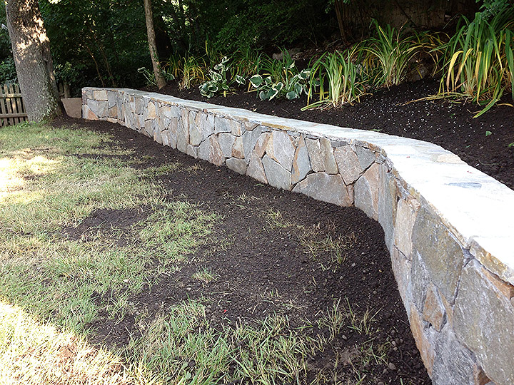 new england landscaper Medford, MA natural stone retaining wall, plantings