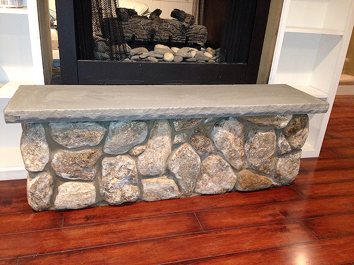 new england landscaper Exeter, NH interior natural stone fireplace, limestone cap
