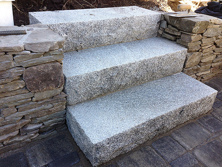 new england landscaper Medford, MA natural stone wall, granite steps
