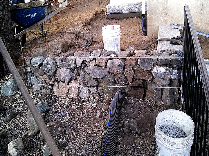 new england landscaper Melrose, MA natural stone wall, drainage