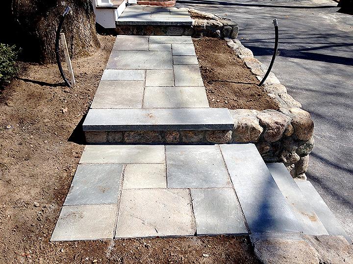 new england landscaper Arlington, MA natural stone wall, bluestone walkway