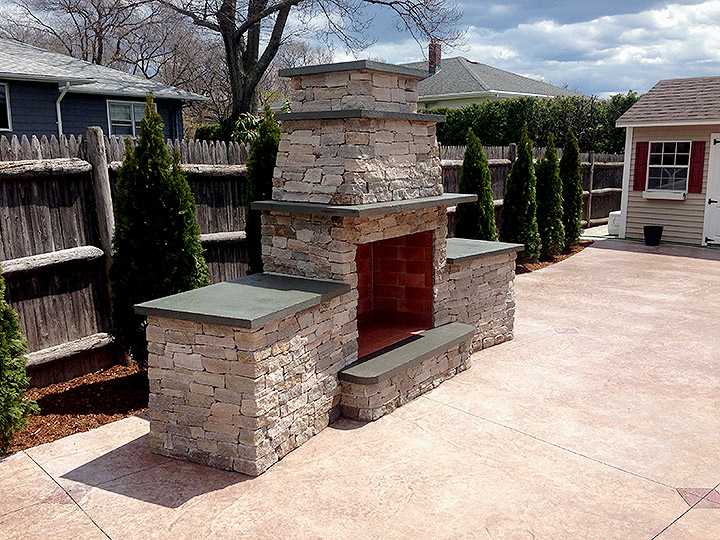 new england landscaper Medford, MA natural stone outdoor fireplace