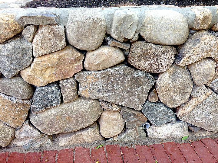 new england landscaper Cambridge, MA natural stone wall, drainage