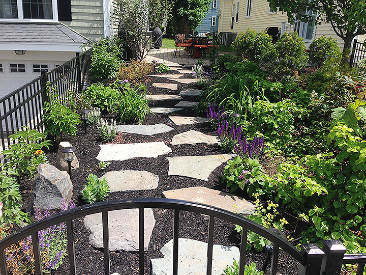 new england landscaper Arlington, MA stepping stone path, decorative rocks, plantings, landscape lighting