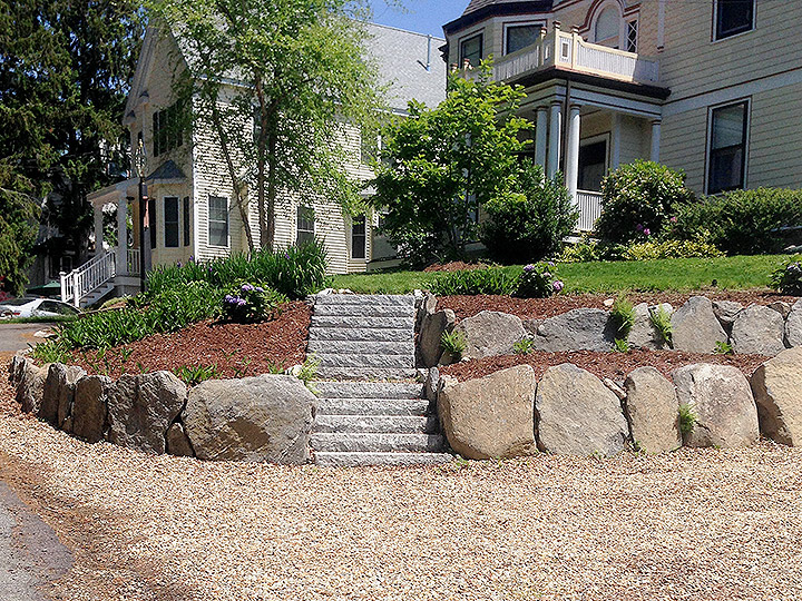 new england landscaper West Medford, MA natural stone wall, granite steps, plantings