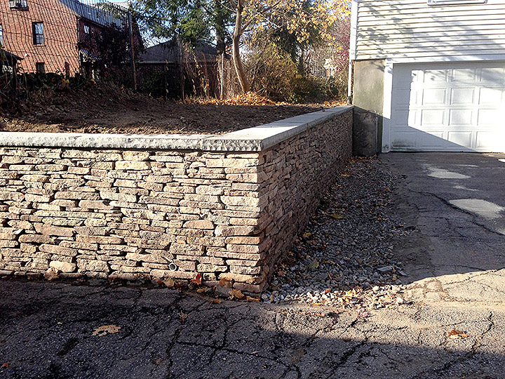 new england landscaper Belmont, MA natural stone wall