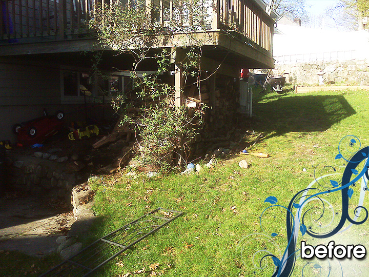 new england landscaper Melrose, MA before: deck removal, retaining wall, stone slab patio, stairs, rock, outdoor lighting, irrigation, hydroseed