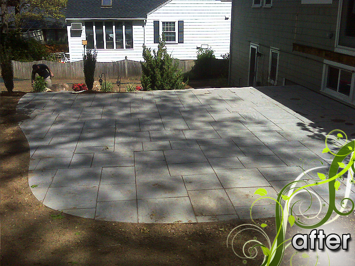 new england landscaper Melrose, MA after: deck removal, retaining wall, stone slab patio, stairs, rock, outdoor lighting, irrigation, hydroseed