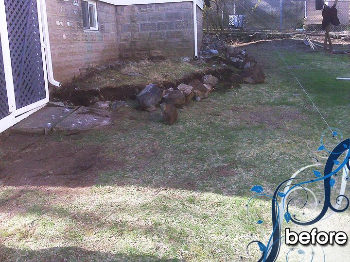 new england landscaper Arlington, MA before: raised patio, retaining wall, walkway, drainage