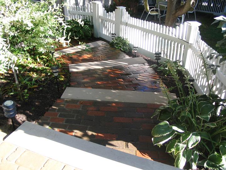 new england landscaper Medford, MA clay brick stairs, limestone treads