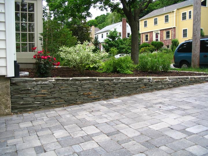 new england landscaper Brookline, MA irregular bluestone wall, granite curb, paver driveway, drainage