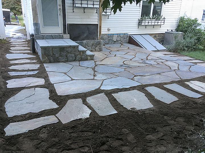 new england landscaper North Reading, MA bluestone patio, granite treads, natural stone stairs and wall, bluestone path