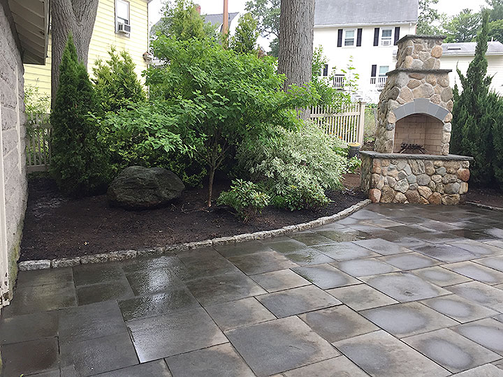 new england landscaper North Reading, MA bluestone patios, cobblestone edge, natural stone outdoor fireplace