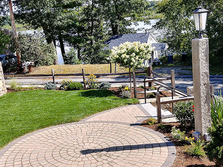 new england landscaper North Reading, MA granite steps, natural stone wall, reclaimed columns, reclaimed grainite light post, landscape lighting, drywell, irrigation, plantings, hydroseed