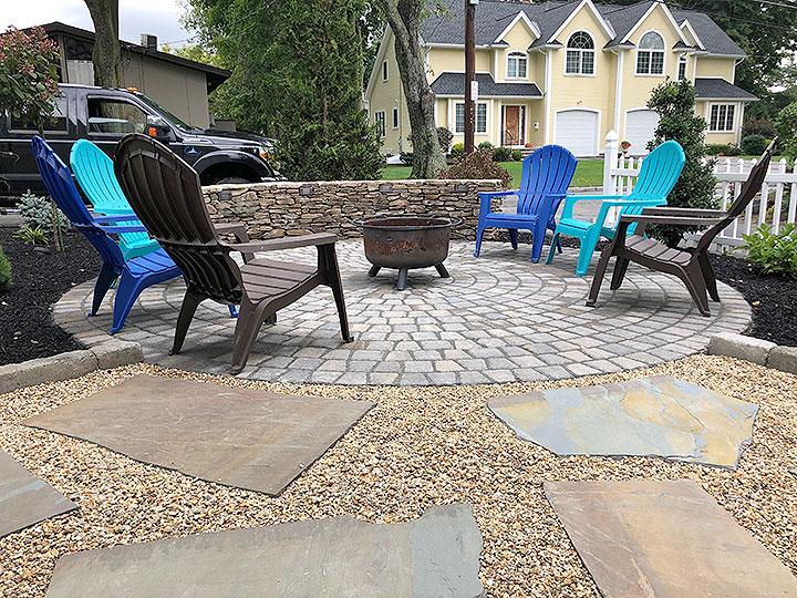 new england landscaper North Reading, MA paver patio, fieldstone wall, cobblestone edge, bluestone featured path, plantings, irrigation