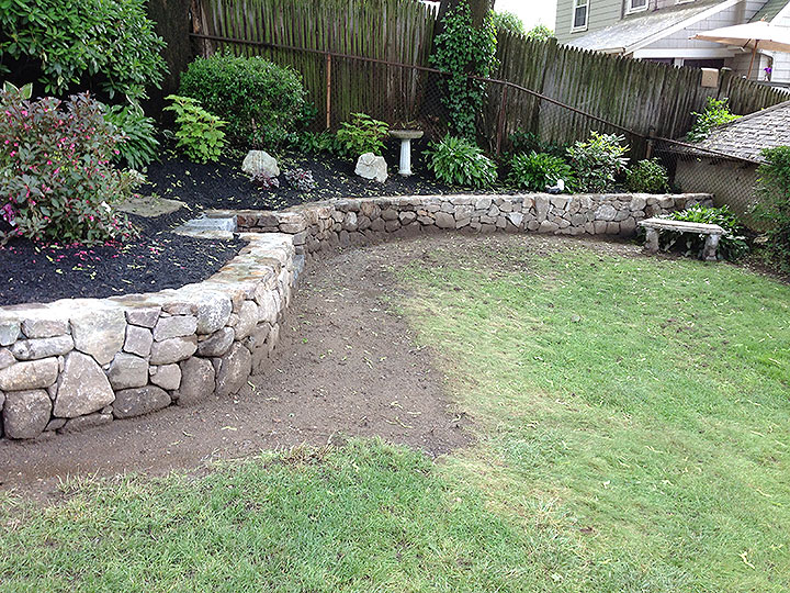 new england landscaper Andover, MA natural stone wall, reclaimed granite steps, plantings