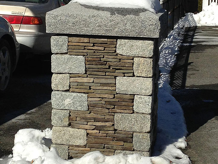 new england landscaper Andover, MA stone pillar with reclaimed granite and fieldstone accents