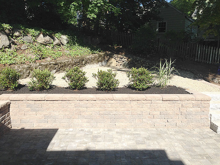 new england landscaper Andover, MA paver patio, block wall, plantings