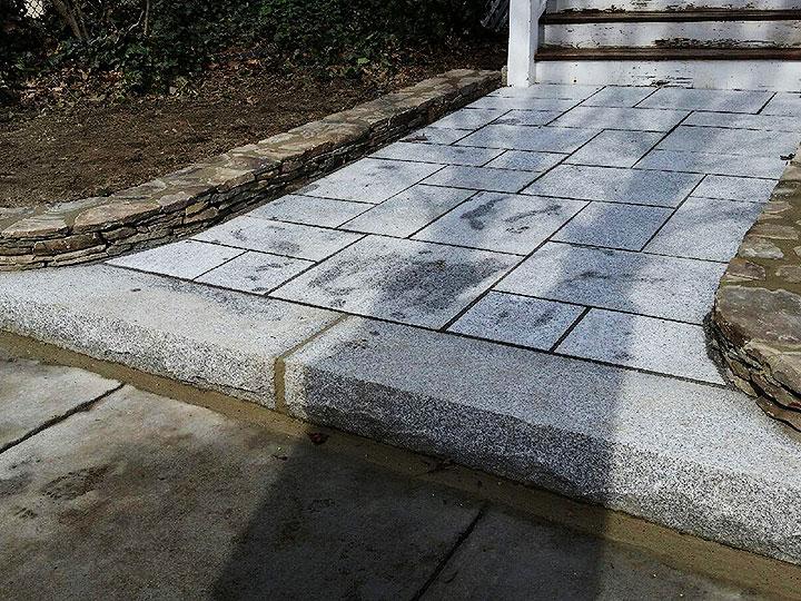 new england landscaper Andover, MA fieldstone wall and edge, granite step, thermal bluestone walkway