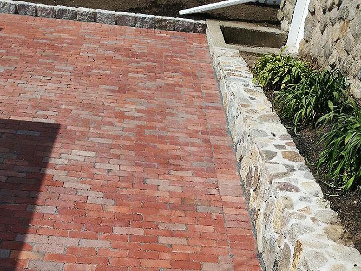 new england landscaper Andover, MA Boston City Hall brick patio, natural stone wall, cobblestone edge