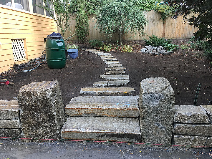 new england landscaper Andover, MA reclaimed granite wall, steps, columns, walkway