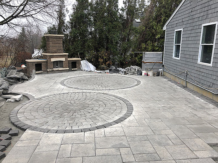 new england landscaper Andover, MA paver patio, stone outdoor fireplace with storage