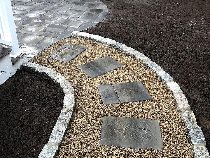 new england landscaper Andover, MA stone walkway, pea stone path, cobblestone edge