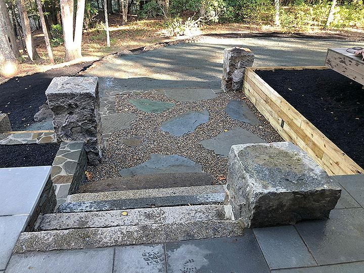 new england landscaper Andover, MA thermal bluestone patio, reclaimed granite columns, bluestone stepping stones, bluestone wall
