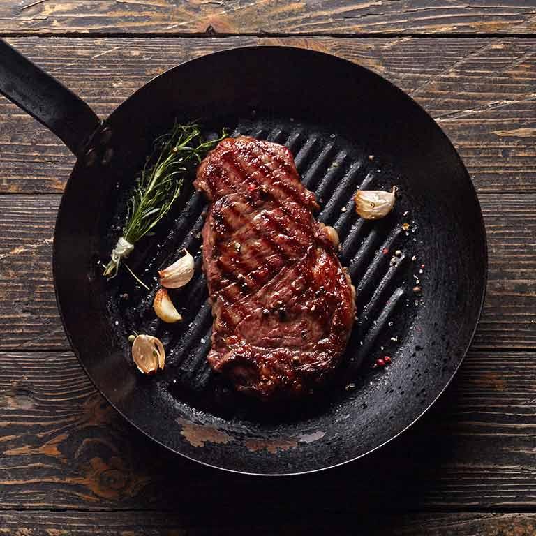 Tender fillet steak pan fried with garlic