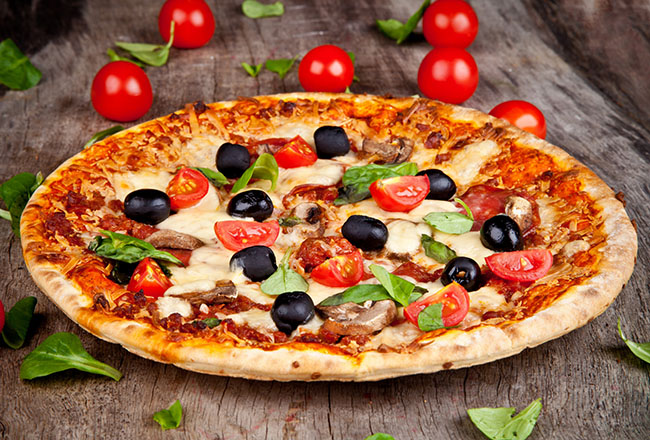 Homemade authentic Italian pizzas cooked in a real wood burning oven